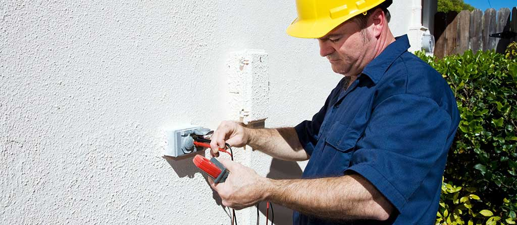 licensed electrician performing external electrical home repair near me