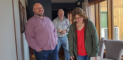 Cori and Ellen Young, owners of Young Electric in Wichita, talking with Phillip Elders about a recent commercial electrical project.