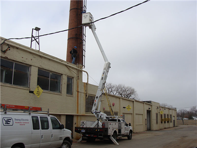 Young Electric truck performing commercial electrical work